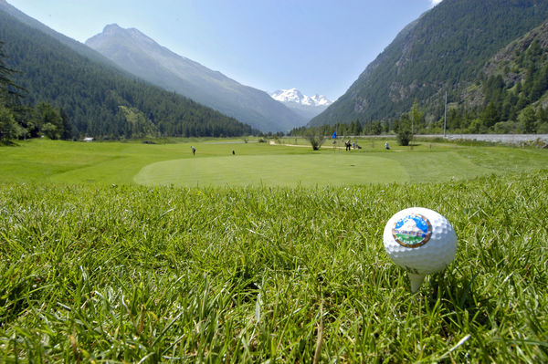 Golfers playing on the green in Täsch near Zermatt see as far as the Breithorn (4,164 m) above Zermatt.
