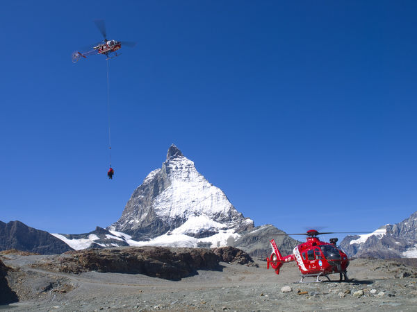 Helicopters working as a team. For both mountain rescue and transportation, professional teamwork is important.