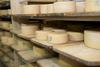 The cheeses are matured on wooden boards.