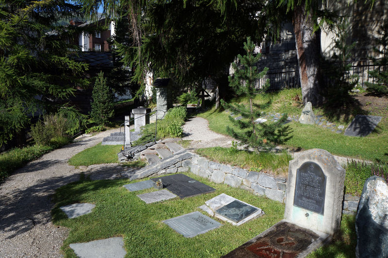 Memorial plaques and gravestones at the mountaineers' cemetery in Zermatt, recalling accidents in the surrounding mountains.