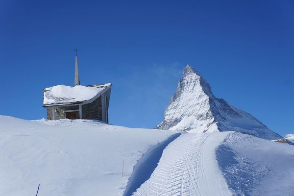 The form of the Riffelberg chapel echoes that of the Weisshorn (right, behind the clouds).