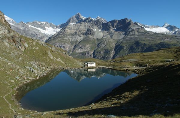 The Schwarzsee lake high above Zermatt lies in a hollow right at the foot of the Matterhorn.