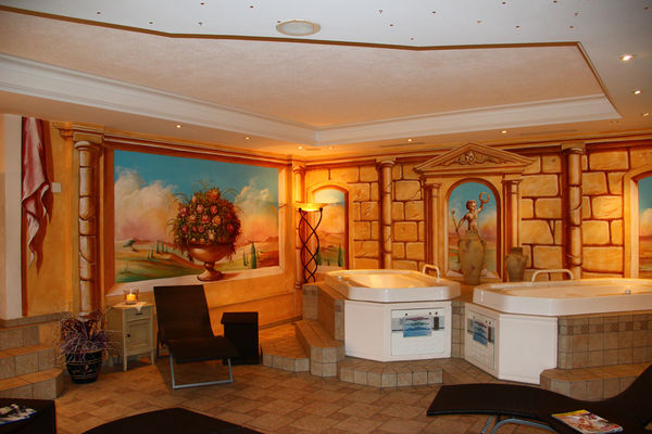 Trompe l'oeil paintings in the spa of the Hotel Chesa Valese conjure a distant world.