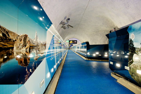 A long, colourfully decorated tunnel leads to the Sunnegga funicular.
