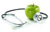 Stetoskop und grüner Apfel