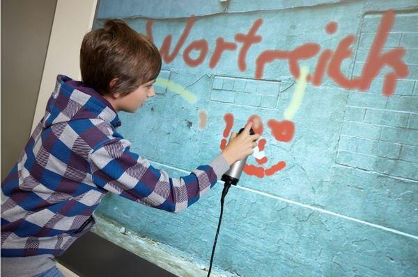 Kapitel 10_Exponat Graffiti-Wand