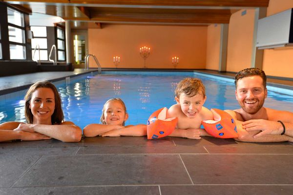 Family in the indoor swimming pool Hotle Hannigalp
