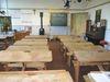Klassenzimmer Sicht auf Tafel