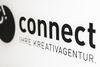 Eingangsschild der Kreativagentur Connect.