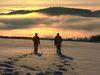 Schneeschuhwandern in der Dämmerung in der Urlaubsregion St. Englmar