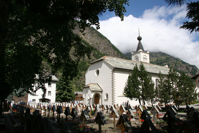 The Roman Catholic church and its cemetery in Täsch, whose wooden crosses carry the names of the faithful departed.