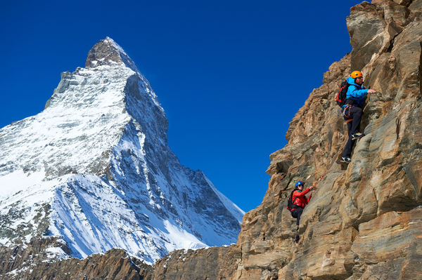 Mountain guide and client, roped up: climbing in Zermatt, in view of the Matterhorn.