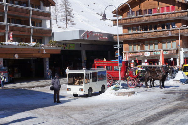 Zermatt station exit: passengers emerge straight onto the Bahnhofplatz square.