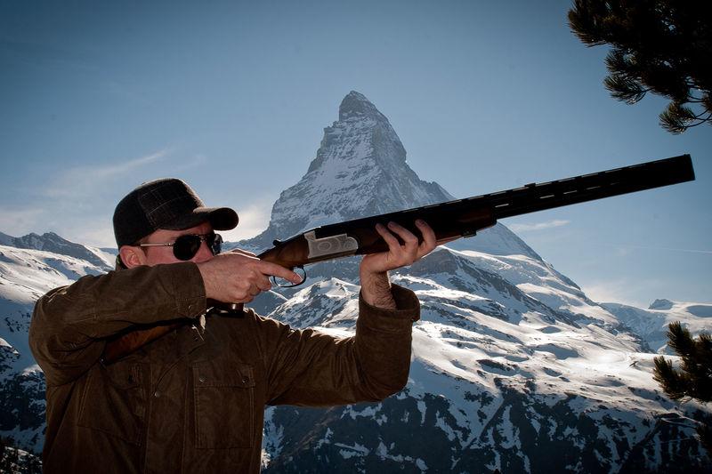 Teams and individuals use infrared shotguns to shoot reusable clay pigeons.