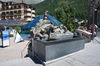 The fountain stands in front of the Matterhorn Museum in the middle of the village.