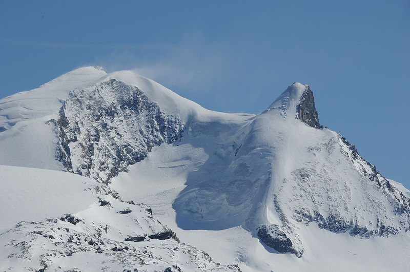 The Strahlhorn (left) is heavily glaciated. On the right, the Adlerhorn.