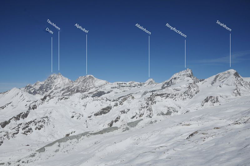 The Täschhorn belongs to the Mischabel group; seen from Zermatt, it appears as a sharp pinnacle in front of the blunter, double-peaked Dom.