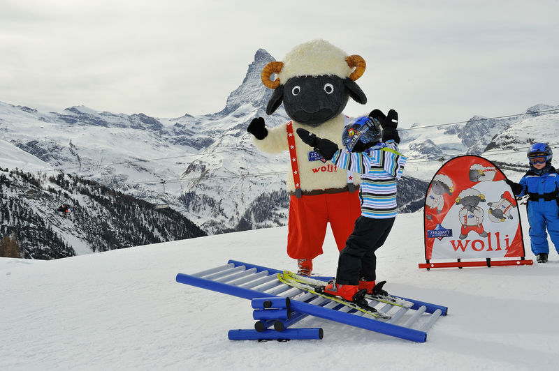 Wolli's park for beginners at Leisee, Zermatt: Wolli shows a budding young skier some balance tricks.